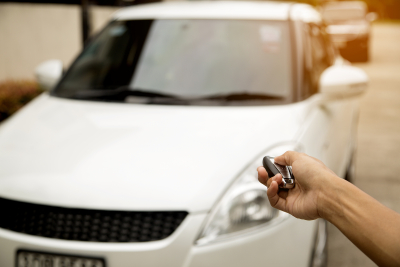 Person using a remote starter for his new white car